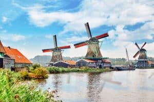 Authentic Zaandam mills on the water channel in Zaanstad village