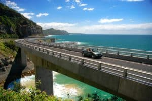 car on bridge along coastal highway